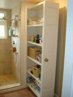 Bathroom storage I like pull out ...wall side is closed off