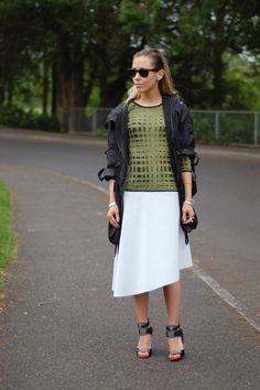 white asymmetrical skirt with print knit, sporty jacket, & heels