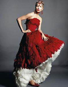 Evoke the exotic with Indian inspirations and plumes. Don't forget the ruby-toned lipstick, like Clarins Joli Rouge in Clarins Red ($23). Gown, headpiece, and shoes, prices upon request, and earrings, $1,145, Alexander McQueen. 212-645-1797.