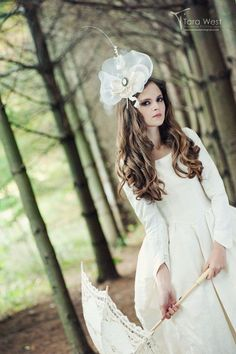 https://www.etsy.com/listing/102240487/lady-nightshade-bridal-fascinator-hat-as?ref=shop_home_active_1