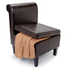 """The Clutter Storing Accent Chair - Hammacher Schlemmer - The seat lifts up on two hinges and secures with a locking arm, revealing a spacious 7 1/2"""" H x 19 1/2"""" W x 18"""" D felt-lined compartment."""