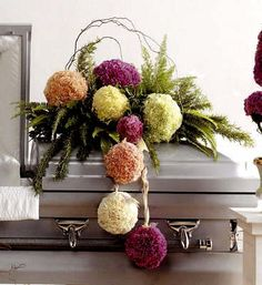 I know it's morbid to look at casket sprays, and I hate carnations but I like this arrangement