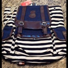 Navy Blue and White Backpack New and never used navy and white striped backpack with brown trim.  Side and front pockets with adjustable straps. Bags Backpacks