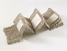 "Handmade book by Aimee Lee. Knit Sestina, spun and knit handmade mulberry paper, typed poem, thread, 5.5 x 32"" opened."