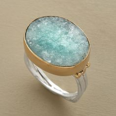 RIO GAZING RING--Hand-textured aquamarine conjures up the color and depths of Rio's calming sea. Sterling silver band; 14kt gold bezel and accents. USA. Exclusive. Whole sizes 5 to 9.