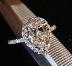 I think this would be an amazing ring!! with a couple of simple bands with it. oh sooo beautiful.