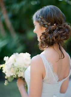 Braided low bun wedding hairstyle: http://www.stylemepretty.com/2017/04/06/finding-the-perfect-combination-of-rustic-and-elegant/ Photography: The Ganeys - http://www.theganeys.com/