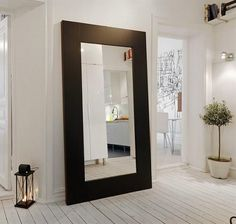 One of the interesting ideas that you can consider applying is placing a hallway mirror in one of the spots in your hallway to make the hallway look wider. Description from depot88.com. I searched for this on bing.com/images