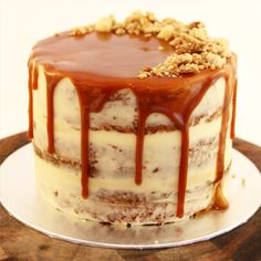 Carrot cake semi naked - with caramel buttercream, caramel drizzle glaze and walnut + macadamia crumble