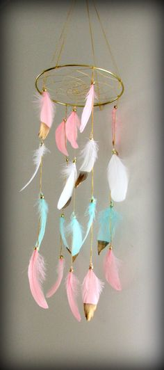 Coral Pink and Mint Baby Mobile, Dream catcher Mobile, Boho Feather Mobile, Nursery Mobile, Woodland Mobile, Native American Style by FineBubbles on Etsy https://www.etsy.com/listing/458868598/coral-pink-and-mint-baby-mobile-dream