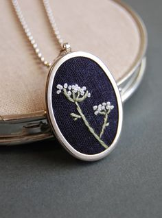 Embroidered Pendant Necklace Queen Anne's Lace on Navy Blue Linen. $20.00, via Etsy.