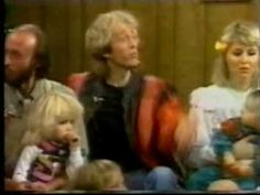 Bee Gees with their wives and children singing- Silent Night...sweet