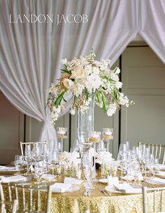 Gold Sequin Table Cloth With A Tall Floral Centerpiece