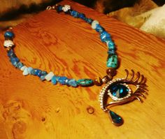 Check out this item in my Etsy shop https://www.etsy.com/listing/501306359/blue-owl-bohemian-eye-necklace-owl