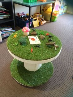 From an old cable reel and artificial grass, ideal for small world play or for displaying items for investigation and exploration
