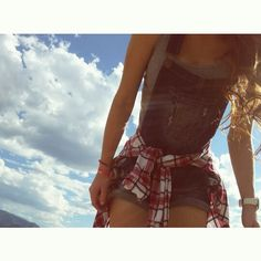 Flannel, overalls, long curls