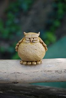 clay owl. I wonder if I had enough of these big enough, would they block the neighbors?