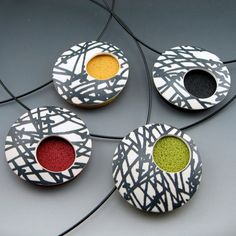 polymer clay pendant necklace with abstract black and white design on black choker neckwire