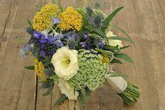 Wild style bridal bouquet with yarrow, lisianthus, delphinium, queen ann's lace, eryngium, eucalyptus.