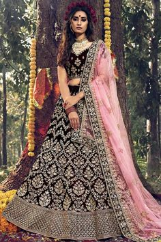Dark Maroon velvet semi stitch lehenga with velvet choli. This lehenga choli is embellished with zari, stone and dori work. Product are available in 32 to 58 sizes. It is perfect for Bridal Wear. #dark maroon #bridal #lehanga #choli# Andaazfashion #USA Indian Wedding Lehenga, Bridal Lehenga Choli, Choli Dress, Wedding Sarees, Indian Bridal, Bollywood Lehenga, Bollywood Dress, Choli Designs, Party Wear Lehenga