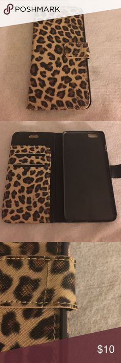 LEPORD PRINT IPHONE 6+ WALLET This is so cute and super trendy!! This is almost in perfect condition. Very clean. There's just a small crack on the fold over clasp and a chip in the plastic phone cover. Priced to sell! Accessories Phone Cases