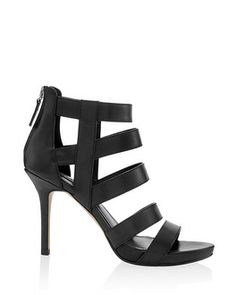 Caged in details bring a bit of edge to these strappy black heels with easy back zip closure and mid-height heel.