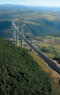 Millau Viaduct Located in southern France, the bridge completes a hitherto… Vacation Places, Places To Travel, Places To See, Beautiful Roads, Beautiful Places, Bridges Architecture, Scary Bridges, Nature Photography, Travel Photography