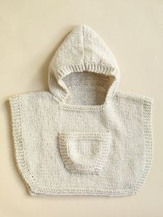 Ravelry: Hooded Baby Poncho #70361AD pattern by Lion Brand Yarn/bulky weight yarn 255-340 yards on size 10 needles