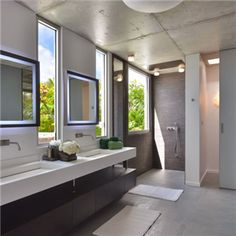 Sleek contemporary bathroom with his and her sinks in luxury home for sale, Corossol, St Barts - http://www.7thheavenproperties.com/property.asp?Id=1508