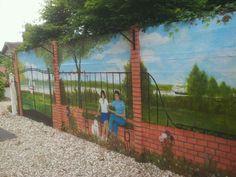 Création d'une Fresque murale dans un jardin.