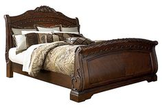 "The North Shore Sleigh Bed from Ashley Furniture HomeStore (AFHS.com). A rich traditional design and exquisite details come together to create the ultimate in the grand style of the ""North Shore"" bedroom collection."