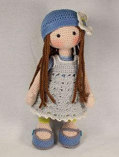 Please note: This listing is for a CROCHET PATTERN to make the pictured doll…