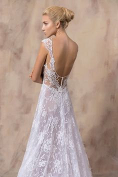 ALISON White A-line dress with a sweetheart neckline , made from hand beaded French Chantilly lace