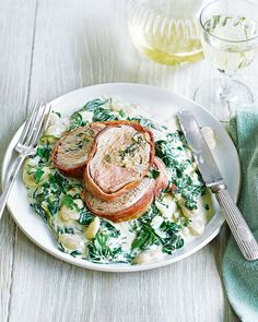 This alternative roast dinner recipe has a parma ham-wrapped pork tenderloin served on a bed of creamed spinach and butter beans.
