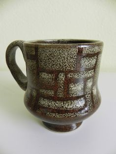 Handmade stoneware mug in red with contrasting overlay. Measures 4 x 3 and holds 12 oz.