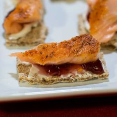 Smoked salmon canapés are a delicious appetizer that is easy to make. The flavors in the smoked salmon compliment the sweetness in the raspberry fruit spread and the crisp rye flavor in the crackers.