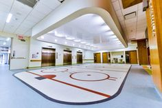 PHOTO TOUR: Shriners Hospital for Children, Montreal, Quebec | Healthcare Design --- The ground floor waiting area for ambulatory clinics and medical imaging is installed on a makeshift hockey rink. Photo: Ben Desjardins