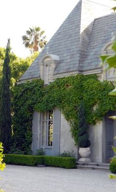 Our favorite house exterior - Love all the colors, the slate roof, the stone, the steps, the color of the shutters, the ivy (just the right amount of ivy - not too much)
