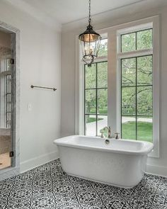 These windows and that freestanding tub is what inspired part of the master bath design of our #modernfarmhouseproject. Designer unknown. Image via @pinterest