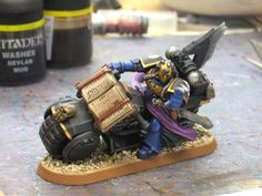 DIY Space Marine Librarian on bike {front wheel cover, but gears instead}