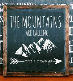 Share your love of outdoor adventure with this hand-painted wood sign. Its lettered with the quote The mountains are calling and I must go and accented with mountain range and arrow illustrations. The square signage is built and framed in solid wood Painted Wood Signs, Wooden Signs, Hand Painted, Painted Letters, Memo Boards, Barn Boards, Chalk Board, Arrow Illustration, The Mountains Are Calling