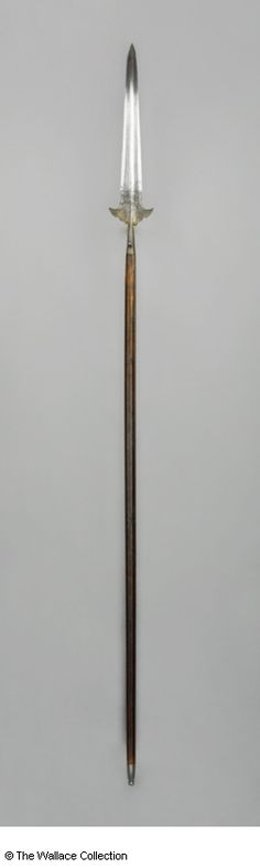 Partizan  Unknown Artist / Maker  Italy  c. 1550  Iron or steel and oak, etched  Length: 70.4 cm, including socket  Length: 11.8 cm, straps  Weight: 2.68 kg  A992  European Armoury III