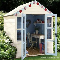 In Need Of Shed Color Ideas?! British bunting on a garden shed. A beautiful shabby chic garden shed.