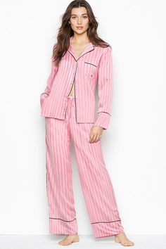 Now entering sleep mode. The silkiest pant and matching long-sleeve top with a chest pocket, notch collar and decorative piping. Easy fit Long-sleeve, button-front top hits below hips Chest pocket with embroidered. Pant with drawstring waist Machine wash.  100% Polyester. Satin Pj Set, Lingerie Catalog, Victoria's Secret, Victoria Secret Pajamas, Womens Pyjama Sets, Pj Sets, Pink Stripes, Pajama Set, Long Sleeve Tops
