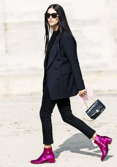 A black top is worn with skinny pants, blazer, chain strap bag, and pink glitter Saint Laurent boots
