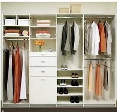 Classic reach in closet design.  Double hanging space, a tower for folded items, some drawers and a space for long hangs.  Simple and efficient.