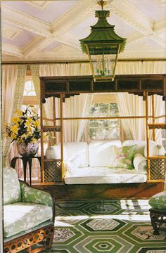 An antique Chinese wedding bed and pagoda lantern in the sunroom.