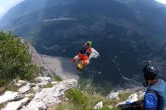 From a 1,000m jump from Monte Brento near Lake Garda in Italy, the BASE jumper and slackliner – wearing just a regular flying suit – jumps ...