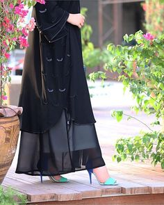 Image may contain: 1 person, standing Niqab Fashion, Modest Fashion Hijab, African Fashion Dresses, Muslim Fashion, Fashion Outfits, Abaya Designs Latest, Mode Abaya, Iranian Women Fashion, Strapless Prom Dresses