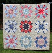 """Zoom imageView large image  Swoon Quilt Kit (80"""" x 80"""")  £120.00 incl tax  This quilt is designed by Camille Roskelly from Thimbleblossoms.   The photograph shows the quilt made in a linen/cotton mix background with a selection of red, white and blue fabrics.   There are nine large blocks. A white background is also an option.  The kit contains:  - pattern & instructions  - all fabrics for the quilt top plus the binding.  A lovely, lovely quilt to make !!  Purchase options  Choose…"""